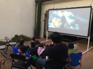 "Watching ""The Lego Movie"" with neighbors and friends."